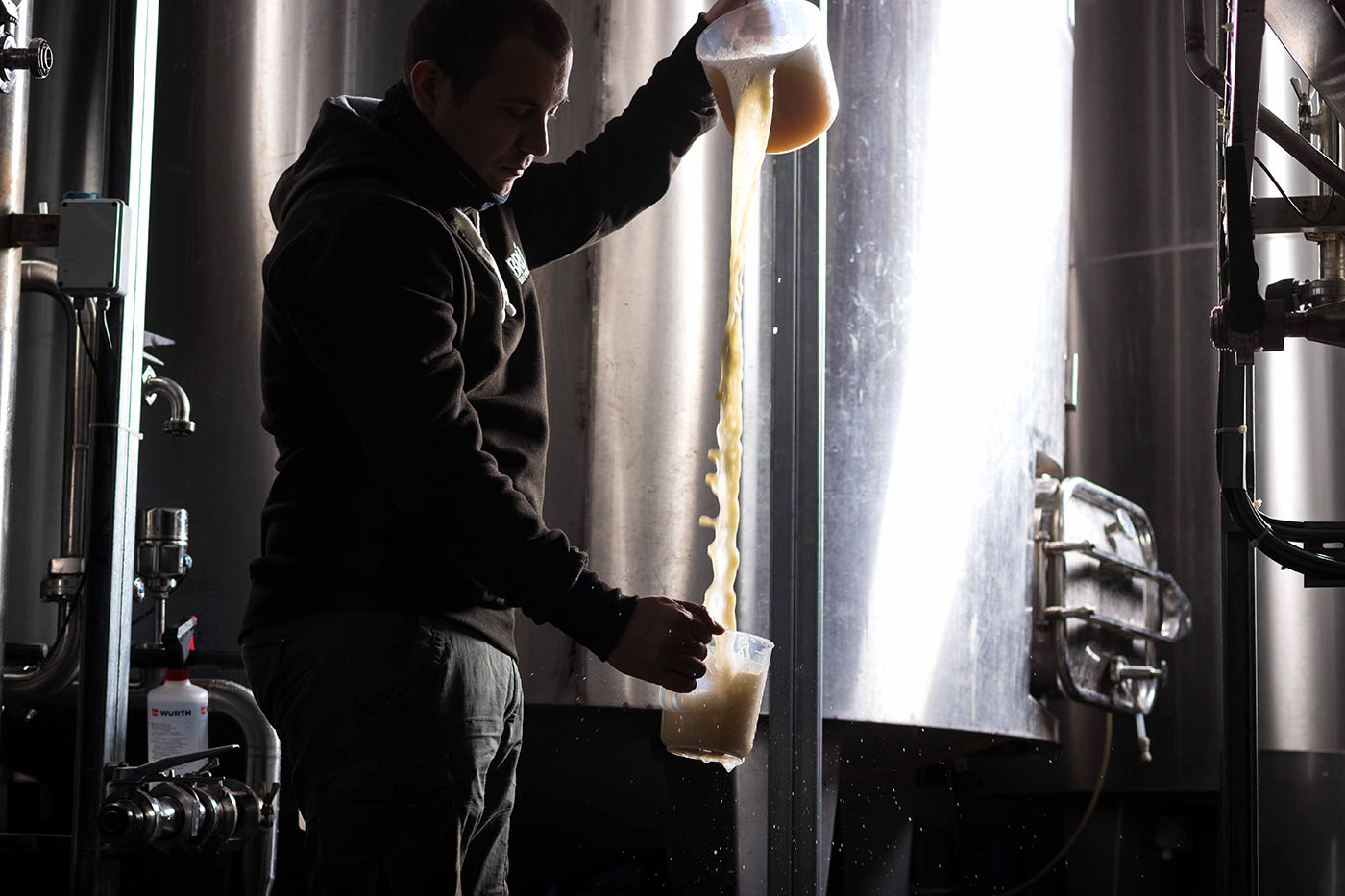 BRÚ Brewery Pouring Beer